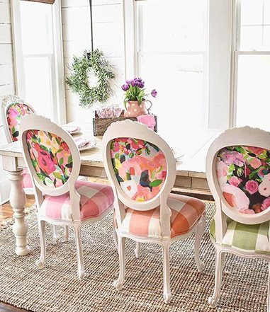 Farmhouse Dining Room With Colorful Patterned Chairs