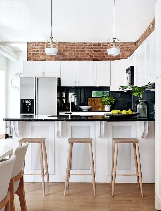 White Kitchen with Brick Above Cabinets