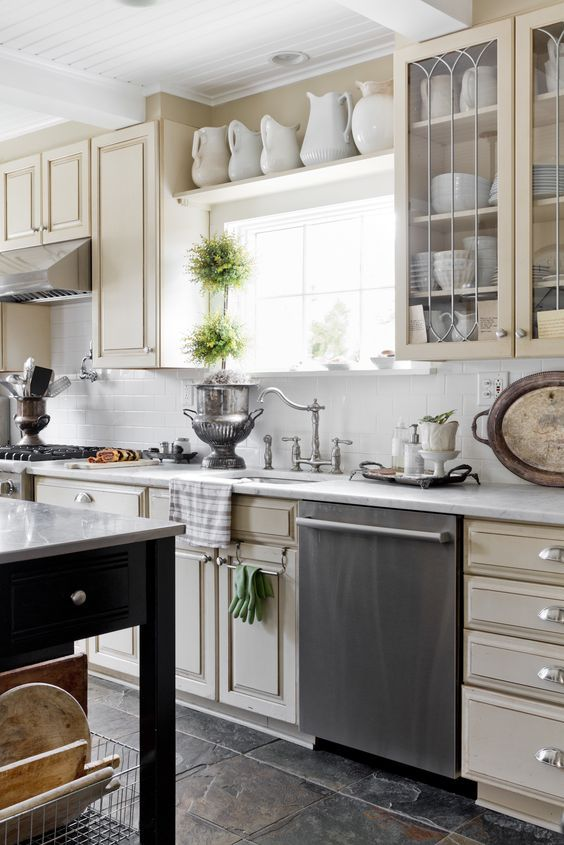 Creamware above Kitchen Cabinets
