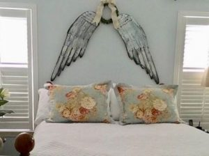angel-wings-above-bed