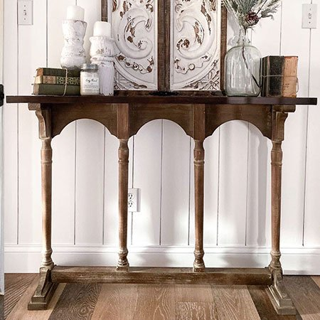 arched spindle console table